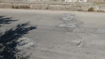 Как выглядит дорога в Изюме после ямочного ремонта - фото